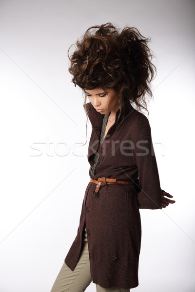 Glamorous Woman in Brown Jacket Looking Down Stock photo © gromovataya