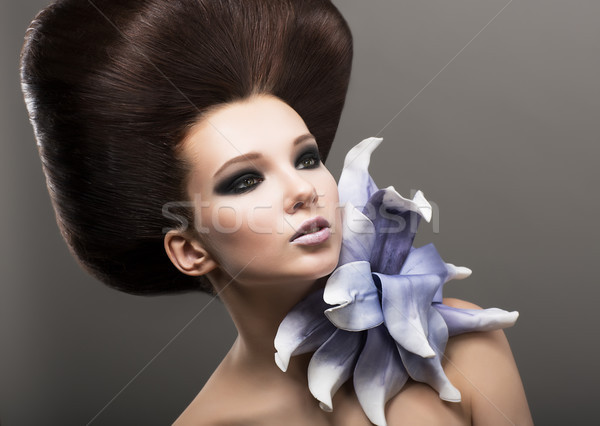 Extravagance. Classy Woman with Lily. Stylish Hairdo. Luxury Stock photo © gromovataya