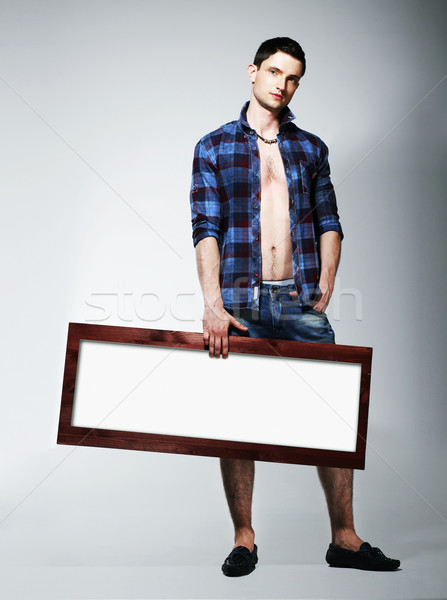 Young Man Showing Placard with White Blank Space Stock photo © gromovataya