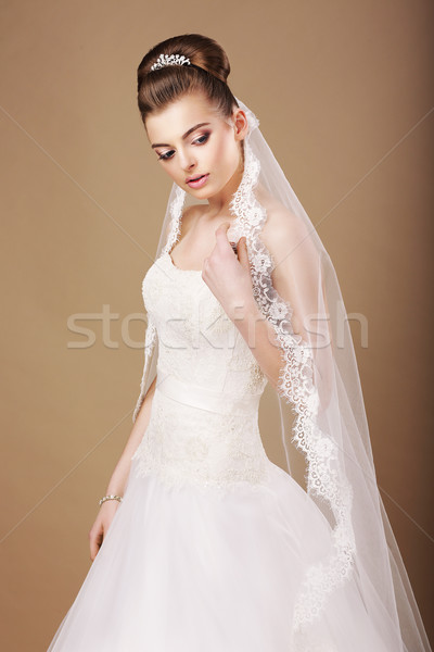 Femininity. Sentimental Bride in White Dress and Openwork Veil Stock photo © gromovataya