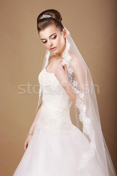 Femminilità sentimentale sposa abito bianco velo donna Foto d'archivio © gromovataya