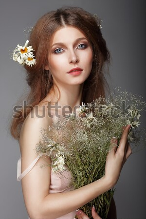 Meditation. Barefoot Genuine Woman with Bouquet of Flowers Stock photo © gromovataya