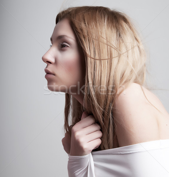 Stock photo: Worried sleepy half-dressed pale woman in white clothes