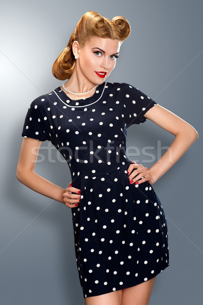 Pin-up girl in retro vintage old-fashioned dress posing Stock photo © gromovataya