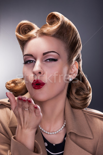 Retro Woman Blowing a Kiss - Old-fashioned Style. Pin Up Stock photo © gromovataya