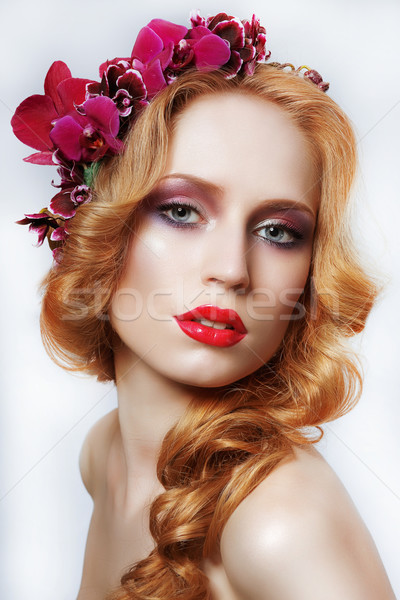 Exquisite Auburn Woman with Wreath of Flowers and Tress Stock photo © gromovataya
