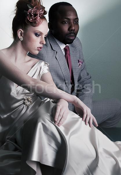 Two fashion models sitting - black man and redhair woman Stock photo © gromovataya