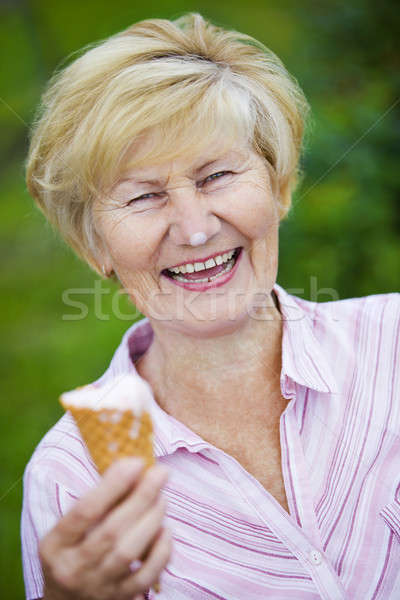 Contentment. Jubilant Ecstatic Old Woman Holding Ice-Cream and Laughing Stock photo © gromovataya