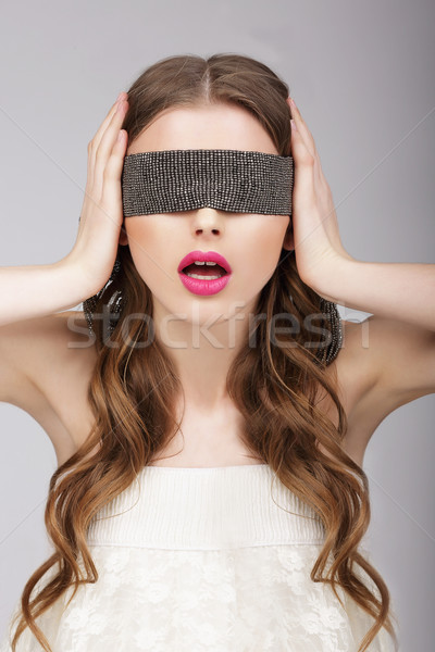 Confusion. Woman holding Headband on her Head Stock photo © gromovataya