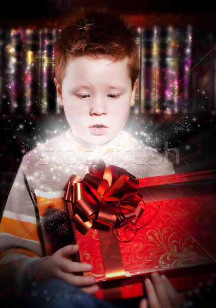 Birthday - lovely excited little kid looks into red gift Stock photo © gromovataya