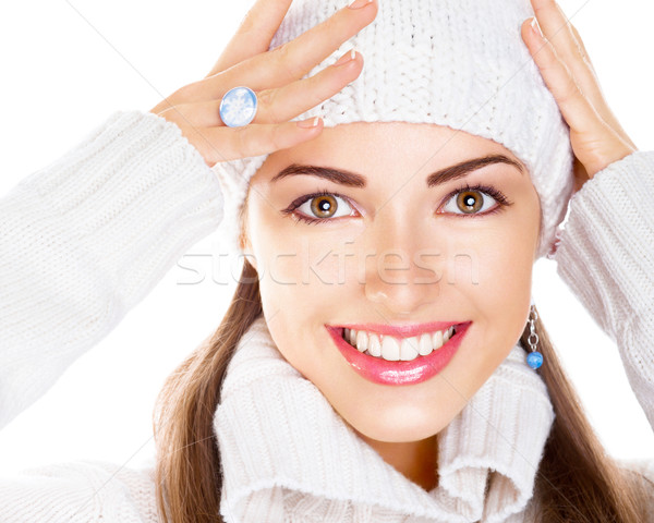 Stock photo: Portrait of beauty woman in white cap and pullover. Happy smile