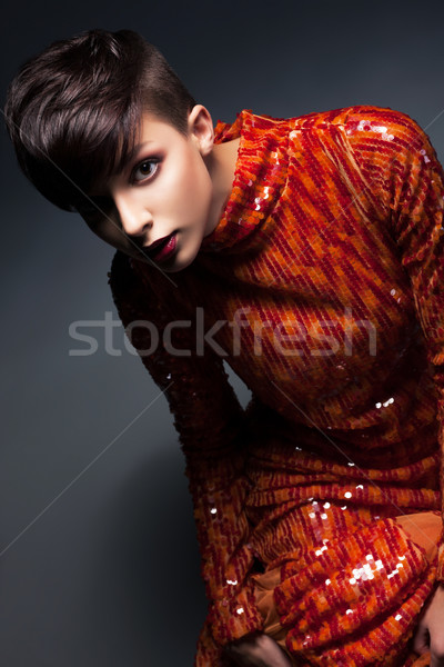 Charme jeune femme rouge robe Photo stock © gromovataya