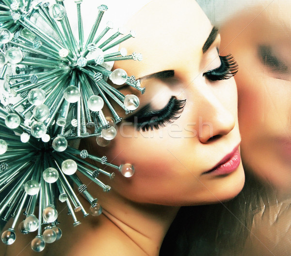 Fashion hairstyle model reflects in mirror - bright makeup Stock photo © gromovataya