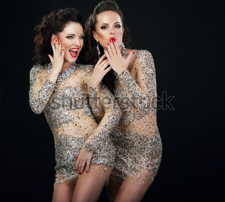 Excited Glamorous Couple in Platinum Dresses Talking Stock photo © gromovataya