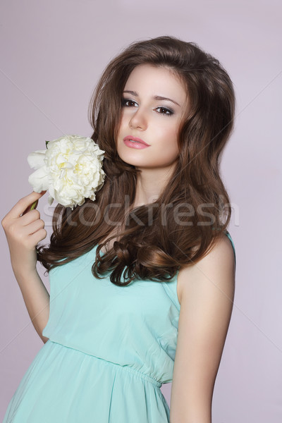 Sincere Gentle Meek Woman with Peony Flower Stock photo © gromovataya