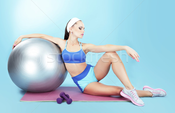 Repose. Sportswoman with Sport Equipment - a Fitness Ball and Dumbbells Stock photo © gromovataya