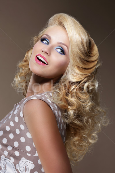 Happy Woman with Frizzy Blond Hairs Looking Up Stock photo © gromovataya