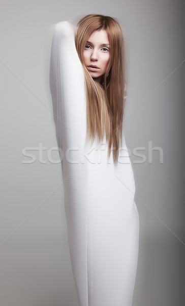 Airy young girl in white clothes posing in studio Stock photo © gromovataya