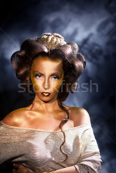 Stock photo: Coloring. Portrait of Styled Woman with Golden Colored Skin