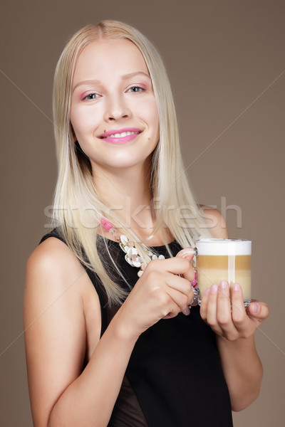 Pleasure. Woman Blonde holding Cup of Morning Coffee Stock photo © gromovataya