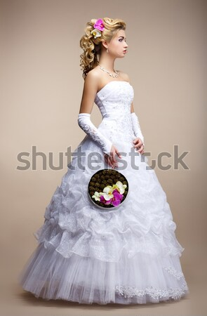 Marriage. Fashionable Bride Blonde in Bridal White Dress and Unusual Bouquet of Flowers Stock photo © gromovataya