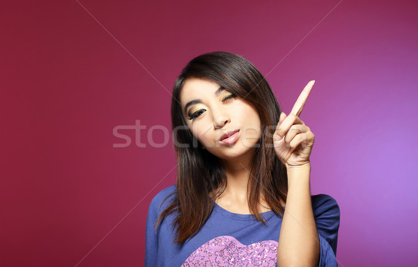 Sale Concept. Friendly Young Saleswoman Pointing with Her Index Finger Upwards Stock photo © gromovataya