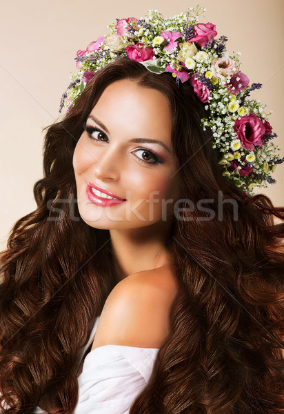 Genuine Young Woman with Flowing Healthy Hairs and Wreath of Flowers Stock photo © gromovataya