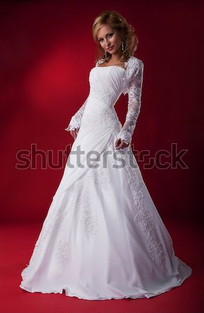 Beautiful fiancee blonde in white nuptial dress posing Stock photo © gromovataya