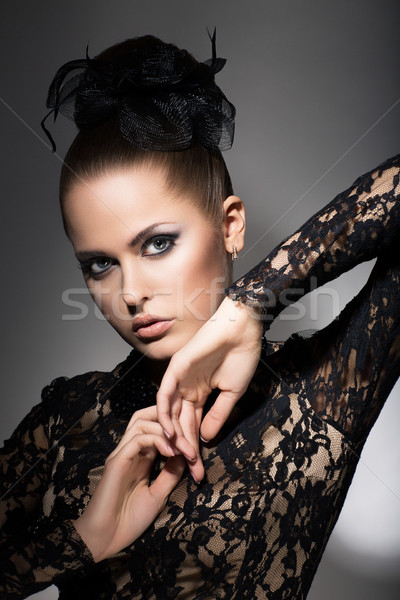 Glamor. Luxurious Woman in Black Dress and Bow. Sophistication Stock photo © gromovataya