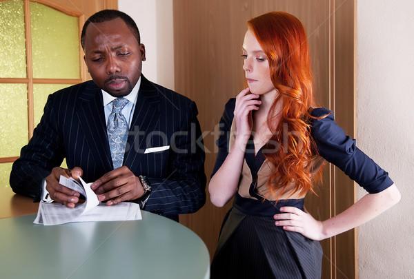 Business meeting between red head woman and black man Stock photo © gromovataya