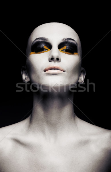 Beautiful bald futuristic unusual woman - clean shaven head. Fashion design Stock photo © gromovataya