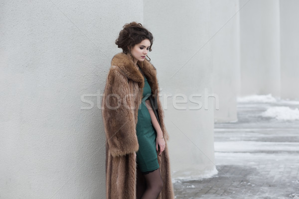 Glamour. Beauty Thoughtful Woman over White Wall in Wool Outwear dreaming Stock photo © gromovataya