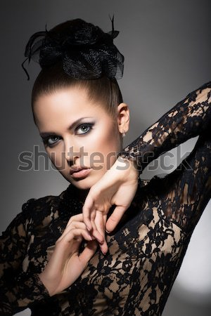 Femininity. Attractive Stylized Woman in Black Dress with Bow-knot. Neatness Stock photo © gromovataya