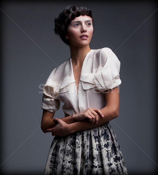 Nostalgia. Exquisite Styled woman in Retro Apparel with Stylish Braided Hair Style Stock photo © gromovataya