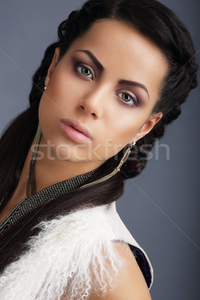 Fascination. Face of Young Nice Looking Brunette with Earrings Stock photo © gromovataya