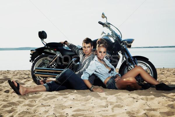 Young handsome boyfriend and girlfriend rider sitting resting Stock photo © gromovataya