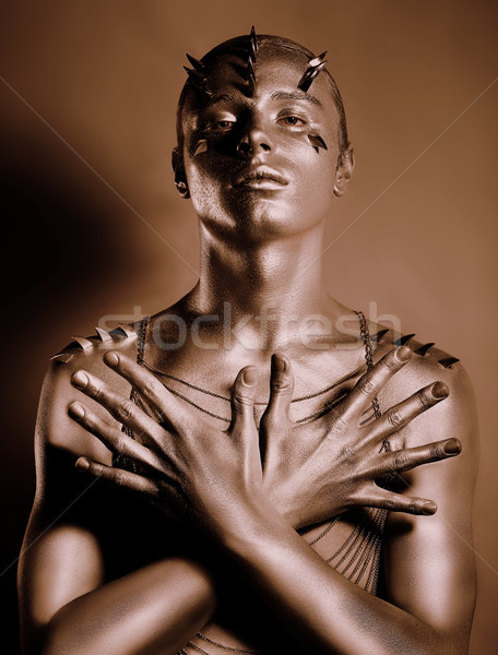Coloring. Bodyart. Bronze Painted Man's Body in Shadow. Grace Stock photo © gromovataya