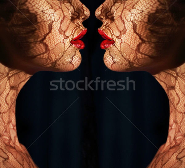 Fantasy. Two Women's Faces with Tracery Opposite each other. Reflexion Stock photo © gromovataya
