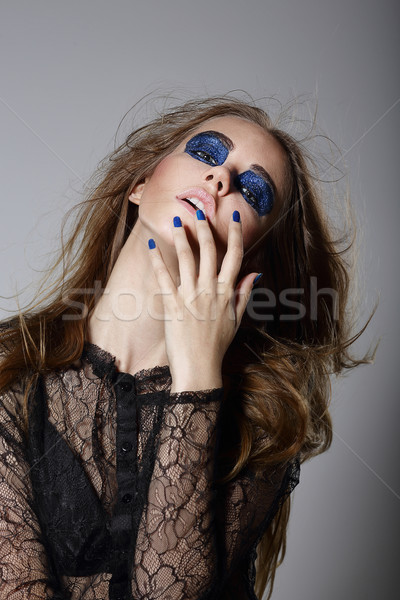 Extravagance. Fancy Woman with Blue Dramatic Makeup and Manicure Stock photo © gromovataya
