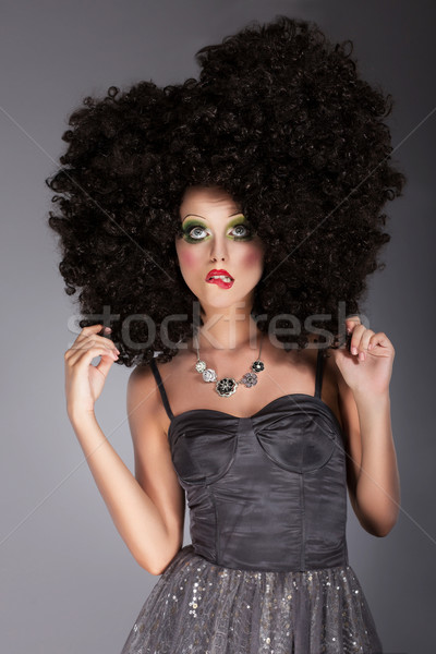 Extravagance. Eccentric Emotional Woman in Frizzy Fancy Wig with Braided Hairs Stock photo © gromovataya