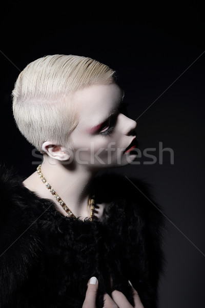 Stock photo: Individuality. Glamorous Well-dressed Blond Woman with Short Haircut