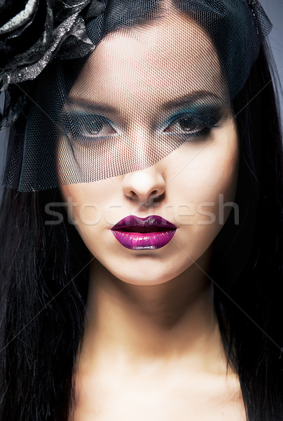 Close-up portrait of a young sad woman with black mourning veil Stock photo © gromovataya