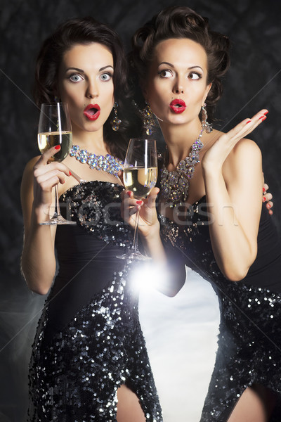 Congratulation! Fashion people with wine glasses of champagne - cheers! Stock photo © gromovataya