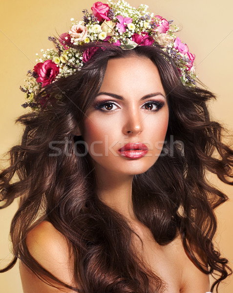 Young Beauty with Wreath of Flowers. Perfect Brown Hairs. Luxury Stock photo © gromovataya