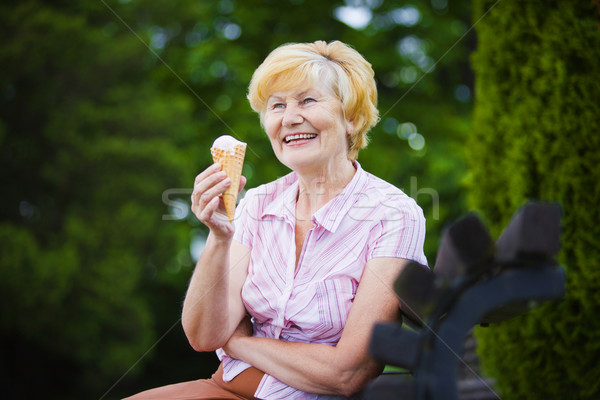 Grey-Haired Woman Relaxing with Ice-Cream on Bench in the Park Stock photo © gromovataya