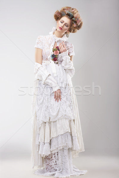 Gorgeous Outre Female in Lacy White Dress with Flowers Stock photo © gromovataya