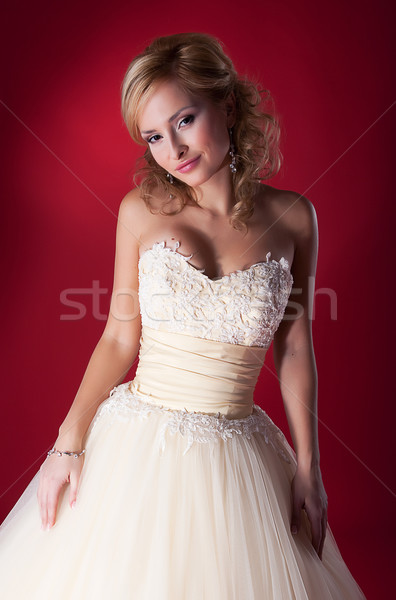 Fiancee in white wedding dress on red background  Stock photo © gromovataya