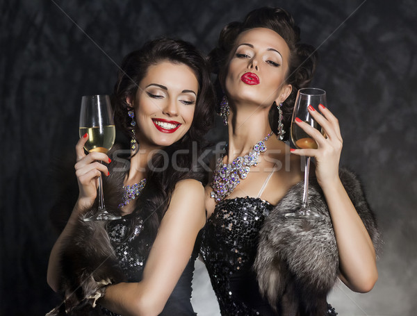 New Year's Eve of two beautiful young women with wine glasses Stock photo © gromovataya