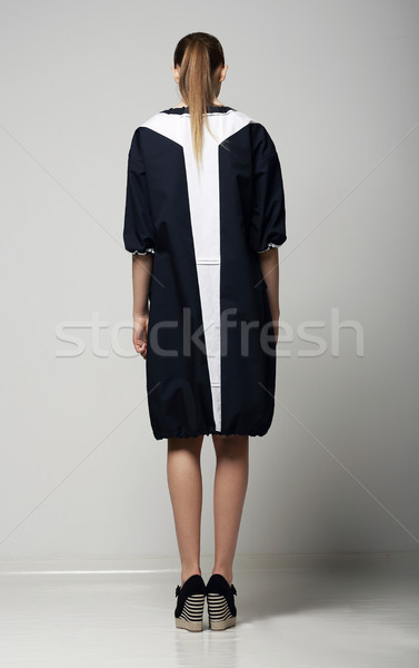 Rear View of of Trendy Chichi Woman in White-Black Contrast Raincoat. Vogue Stock photo © gromovataya