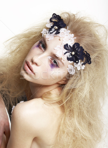 Stock photo: Emotional Caucasian Female with Bright Futuristic Mask and Make-up. Creative Faceart